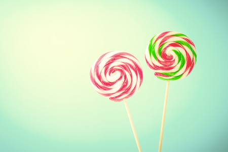 old fashioned sepia: Lollipop on blue background with copy space.,Pastel tone. Stock Photo