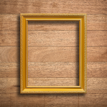 vintage photo: Old picture frame on vintage wood wall. Stock Photo