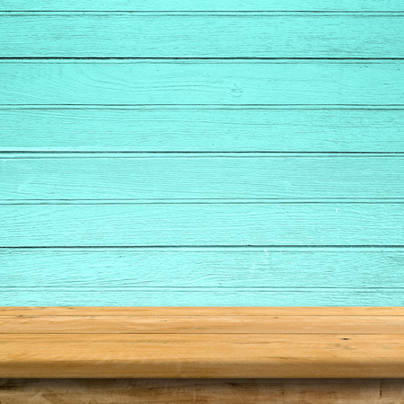blue wall: Vintage wood table in blue wood wall room. Stock Photo