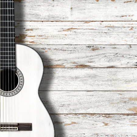 space wood: White classical guitar on vintage wood background with copy space.