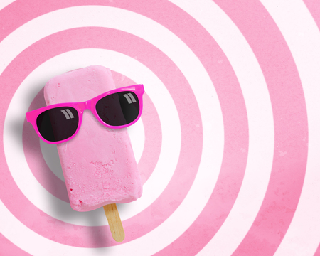 pastel shades: Ice cream stick wearing sunglasses on circle pattern pink and white background with copy space.,Pastel tone. Stock Photo