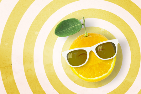 punctuate: Smile orange wearing sunglasses on circle pattern yellow and white background with copy space.,Pastel tone.