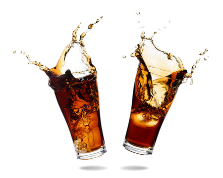 doublet: Couple cola splashing out of a glass., Isolated white background.