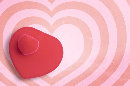 punctuate: Red velvet silk box heart shape on hearts pattern pink and red background with copy space.,Pastel tone.
