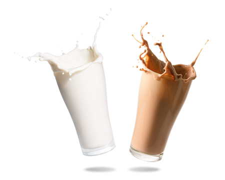 glass containers: Milk and chocolate milk splashing out of glass., Isolated white background. Stock Photo
