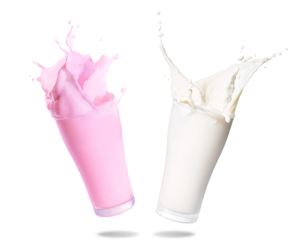doublet: Milk and strawberry milk splashing out of glass., Isolated white background. Stock Photo