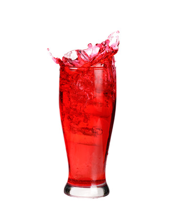 Red cocktail soda splashing out of a glass., Isolated white background.