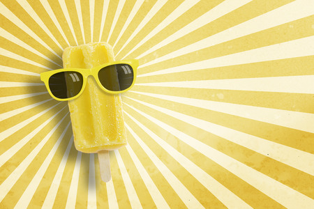 punctuate: Ice cream stick wearing sunglasses on vintage background with copy space., Yellow Pastel tone.
