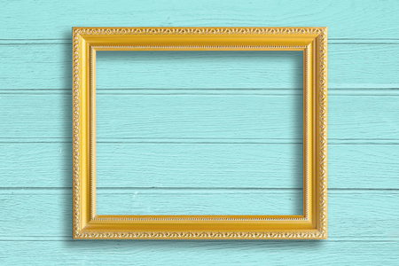 frame on wall: Gold picture frame on vintage wood wall. Stock Photo