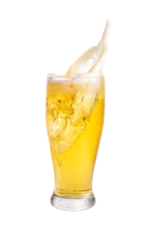 Beer splashing out of glass isolated on white background.