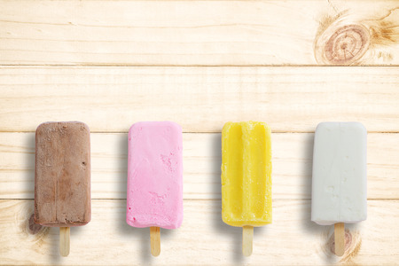 space wood: Ice cream stick put on wood background with copy space.