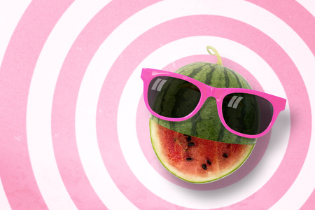 punctuate: Watermelon wearing sunglasses on circle pattern pink and white background with copy space.,Pastel tone.