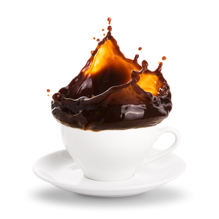 Coffee splashing out of a cup isolated on white background.