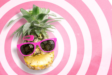 punctuate: Pineapple wearing sunglasses on circle pattern pink and white background with copy space and pastel tone. In summer holiday.