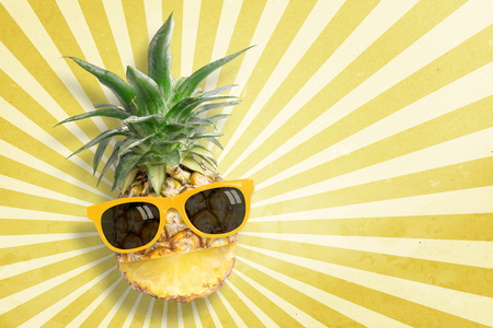 punctuate: Pineapple wearing sunglasses on sunbeam vintage background with copy space and pastel tone. In summer holiday. Stock Photo