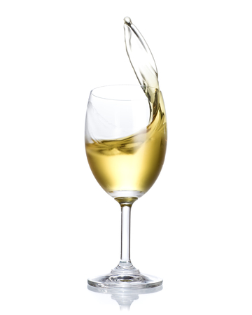 White wine splashing out of glass isolated on white background.