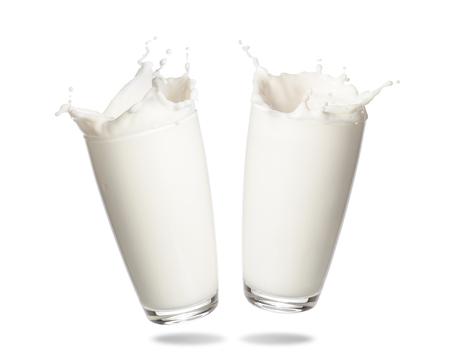 Couple milk splashing out of glass isolated on white background.