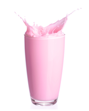 Strawberry milk splash out of glass isolated on white background.
