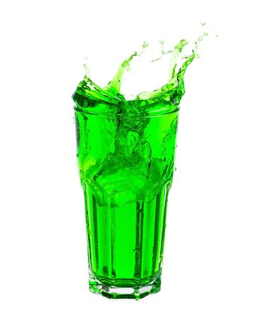 Green soda splashing out of glass isolated on white background.
