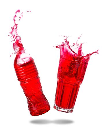 Couple red soda splashing out of glass and bottle isolated white background.