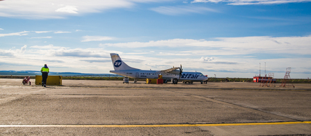 Norilsk, Russia - June 27, 2017: Plane on the runway of Norilsk airport Editorial
