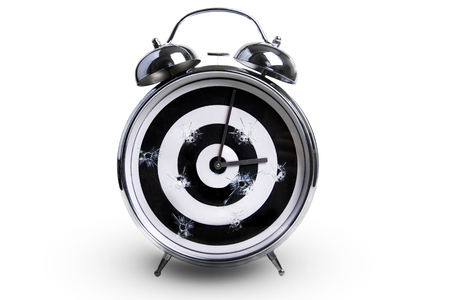 alarm clock in the form of a target as a symbol of time killed