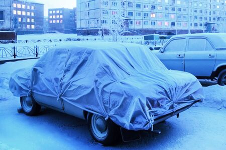 a frozen car is parked in winter