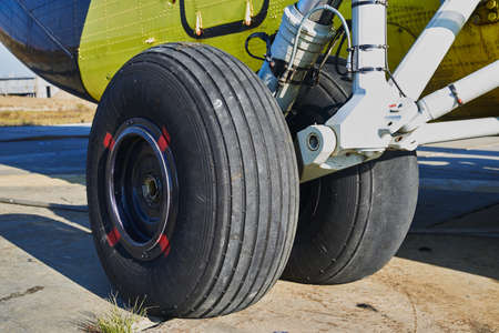 Helicopter landing gear with aircraft thrust pad. Landing gear of military helicopter. Wheel Of Airplane Or Helicopter Stock Photo