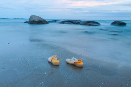 sandles: a pair of sandal on quiet beach, rayong thailand