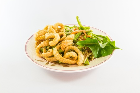 isolated of pork skin fried on plate of spicy papaya salad photo