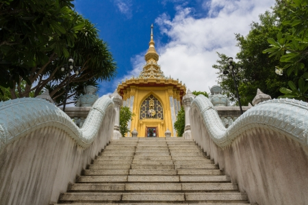 staircase to thai golden statue on top of hill