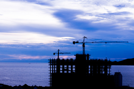 buiding: on sea coast there is a construction buiding