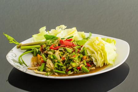 green papaya salad: thai traditional spicy papaya salad in isolation