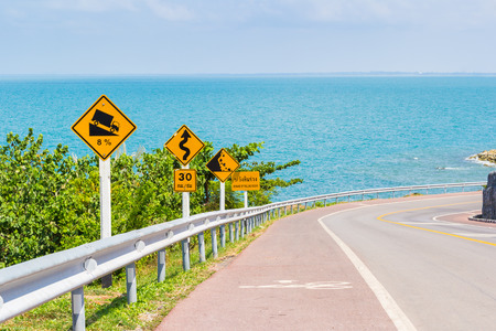 road sign highway sign: traffic sign post on rural with sea view