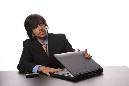 sinecure: Young Bussiness man opening his laptop at the beggining of the day Stock Photo