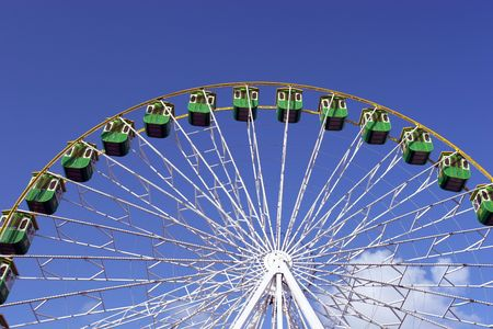 Giant Wheel detail isolated in blue sky background photo