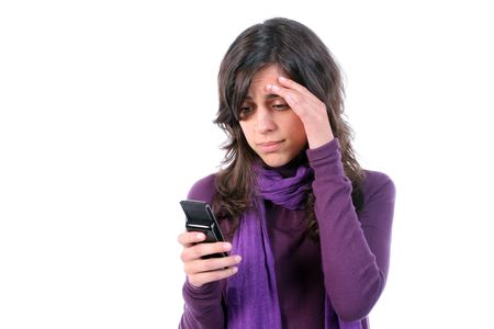 Young tired and with headache, reading a sms on her cellphone, isolated on white background Stock Photo - 2946446
