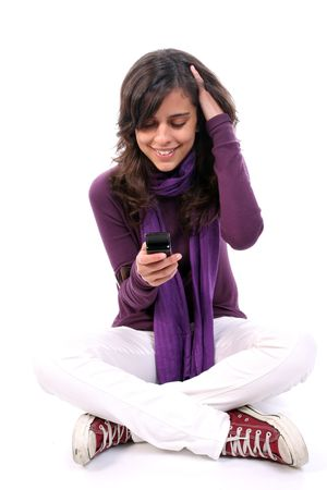 Young Casual Girl, happy, looking at her cellphone, isolated in white background photo