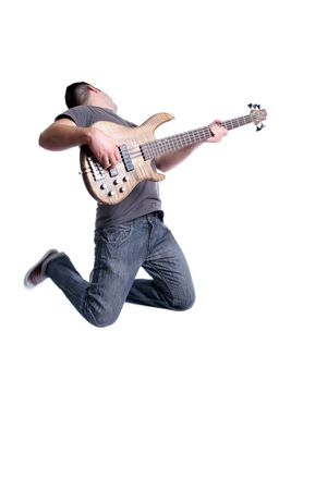 young bass player jumping, isolated on white background photo