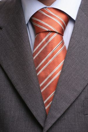 Detail of a suit and a tie in double windsor knot - isolated photo
