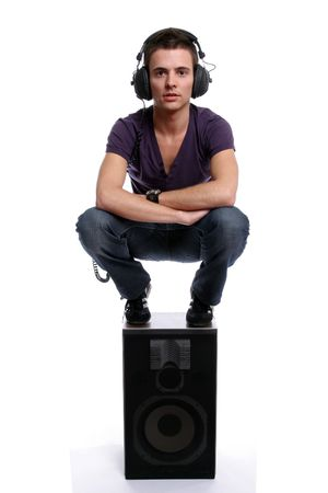 Young man with headphones, stading in a speaker, isolated in white background photo