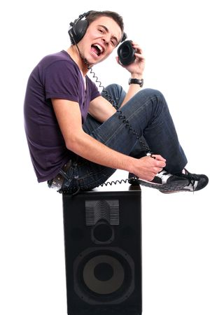dj boy: Young man with headphones, seating in a speaker, isolated in white background