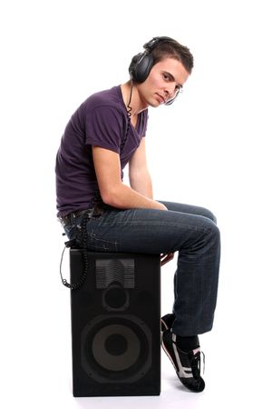 Young casual man listening to music, isolated in white background photo