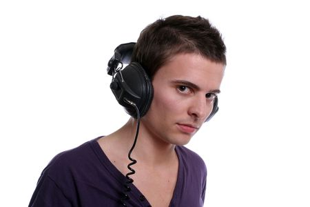 young casual man, listening to music, isolated in white background photo
