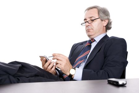 marketeer: Mature Businessman working with PDA, isolated in white