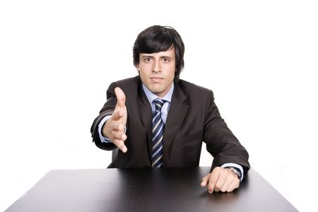 young man in suit offering to shake the hand, isolated in white background photo