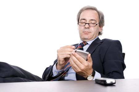 marketeer: Mature Businessman working with PDA, isolated in white background Stock Photo