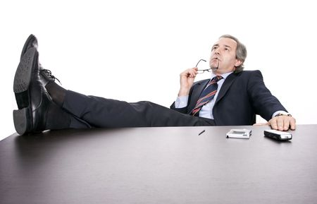Mature businessman working, isolated over white background photo