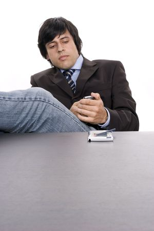 Young worried businessman on the phone, over white background photo