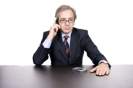 marketeer: Mature businessman on the phone, isolated over white background